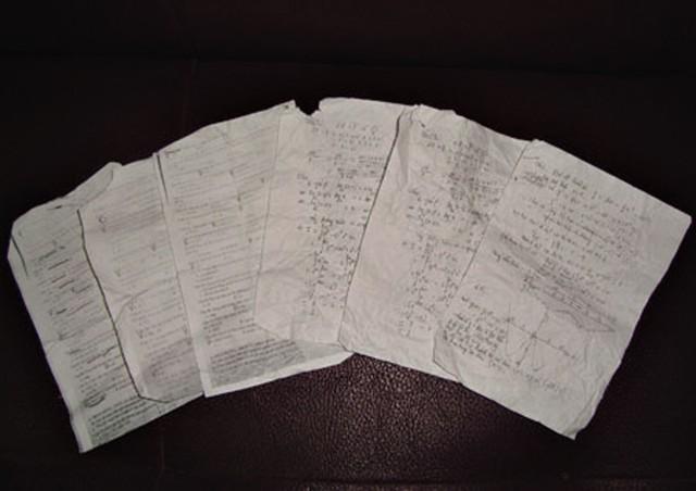 Các tờ photo đáp án được đưa vào phòng thi để thí sinh truyền nhau chép trong phòng thi (năm 2012) được anh Nguyễn Danh Ngọc thu thập lại. Ảnh: Q.Huy