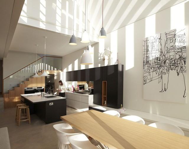 Bảng màu đen của nội thất giúp ngăn cách nhà bếp với không gian ăn uống và sinh hoạt