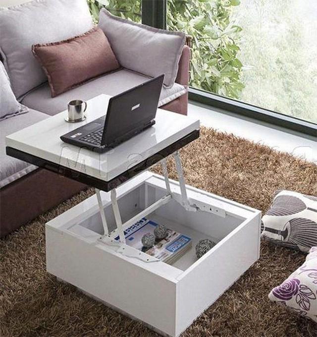 Bàn cà phê đa chức năng với một đầu tăng có thể được sử dụng như một bàn làm việc.