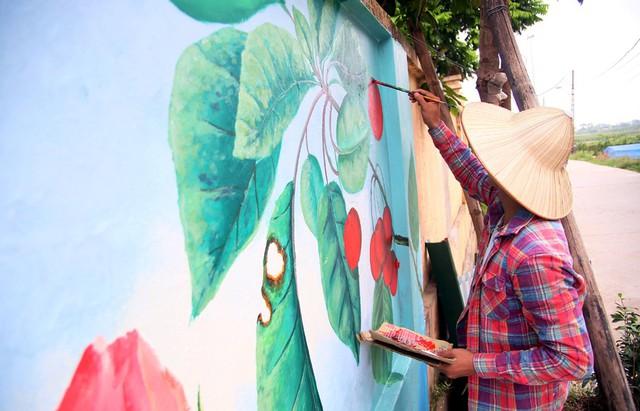 Đột nhập làng bích họa đẹp nao lòng đầu tiên ở Hà Nội khiến nhiều người mê mẩn - Ảnh 14.