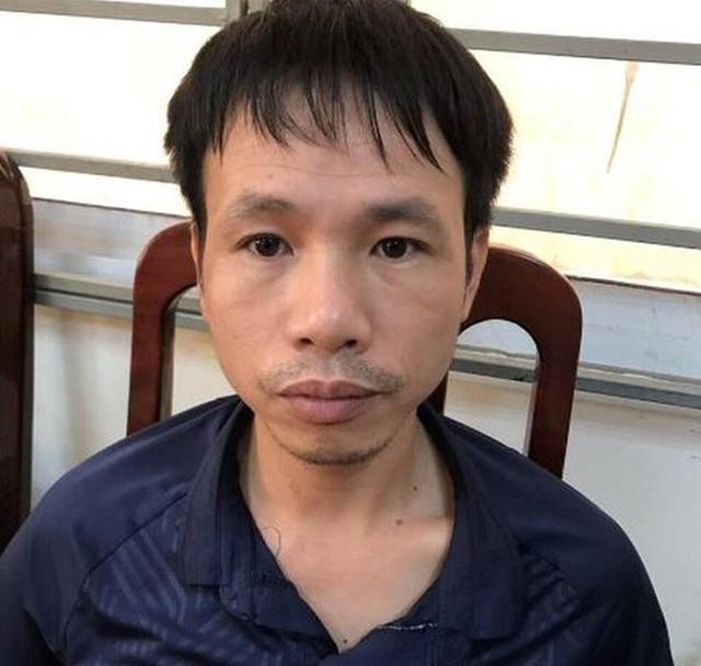 Khởi tố, bắt tạm giam nam thanh niên đốt pháo trên sân Hàng Đẫy làm nữ CĐV bị thương - Ảnh 2.