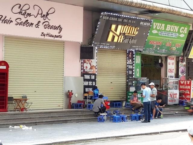 Khám nghiệm hiện trường vụ nổ tại quán trà đá chung cư HH Linh Đàm - Ảnh 5.