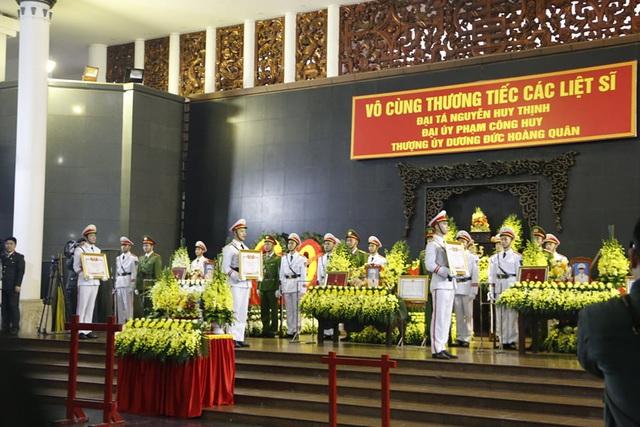 Chuẩn bị di quan 3 thi hài chiến sĩ hy sinh ở Đồng Tâm về nơi an nghỉ cuối cùng - Ảnh 1.
