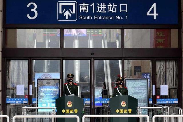 Trung Quốc phong tỏa 3 thành phố, hơn 20 triệu dân bị cách ly vì virus Vũ Hán - Ảnh 1.