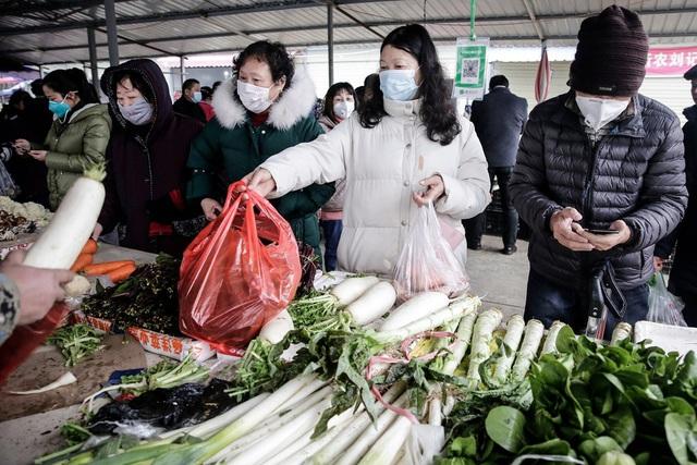Kỳ nghỉ tết kỳ lạ của người Trung Quốc giữa cơn ám ảnh virus corona - Ảnh 2.