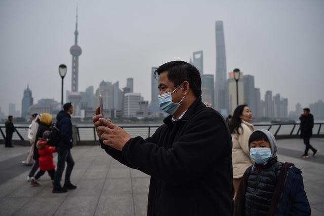 Kỳ nghỉ tết kỳ lạ của người Trung Quốc giữa cơn ám ảnh virus corona - Ảnh 13.