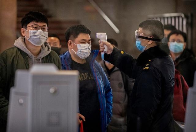 Kỳ nghỉ tết kỳ lạ của người Trung Quốc giữa cơn ám ảnh virus corona - Ảnh 6.