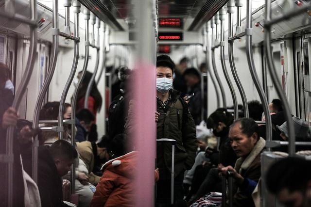 Kỳ nghỉ tết kỳ lạ của người Trung Quốc giữa cơn ám ảnh virus corona - Ảnh 7.