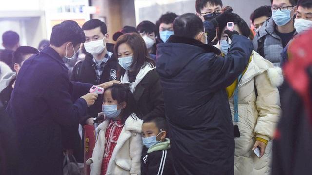 Virus Vũ Hán bắt đầu tàn phá kinh tế Trung Quốc - Ảnh 1.