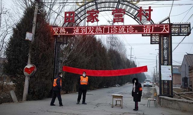 Những làng tự phong toả dịch viêm phổi Vũ Hán  - Ảnh 1.
