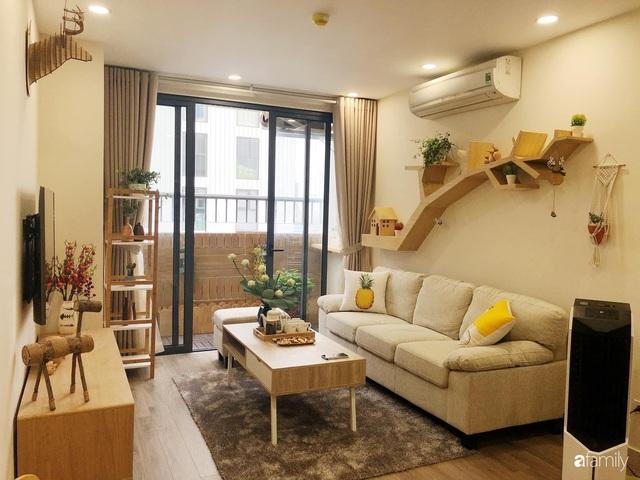 Căn hộ 76,9m² ấm áp với đủ loại hoa và nội thất gỗ ở Mỹ Đình, Hà Nội - Ảnh 2.
