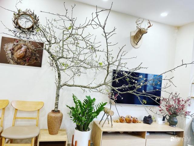 Căn hộ 76,9m² ấm áp với đủ loại hoa và nội thất gỗ ở Mỹ Đình, Hà Nội - Ảnh 6.