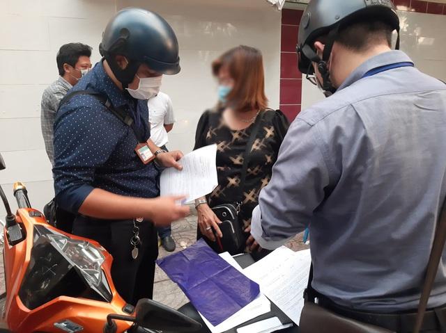 Nhiều người dân bị phạt hành chính do không đeo khẩu trang - Ảnh 6.