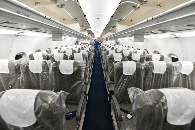 Những hình ảnh chưa biết về chuyến bay đưa công dân Việt Nam từ Vũ Hán về nước - Ảnh 9.