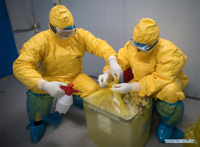 Hình ảnh những người chuyên gom mẫu bệnh phẩm Covid-19 ở Vũ Hán - Ảnh 10.