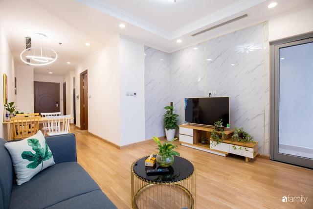 Chỉ vỏn vẹn 56m² nhưng căn hộ nhỏ dưới đây lại rộng thoáng bất ngờ nhờ cách bài trí thông minh của chủ nhà ở Hà Nội - Ảnh 2.