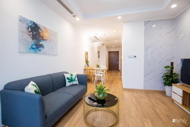Chỉ vỏn vẹn 56m² nhưng căn hộ nhỏ dưới đây lại rộng thoáng bất ngờ nhờ cách bài trí thông minh của chủ nhà ở Hà Nội - Ảnh 3.