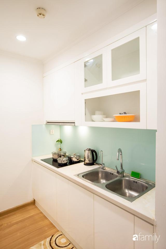 Chỉ vỏn vẹn 56m² nhưng căn hộ nhỏ dưới đây lại rộng thoáng bất ngờ nhờ cách bài trí thông minh của chủ nhà ở Hà Nội - Ảnh 12.