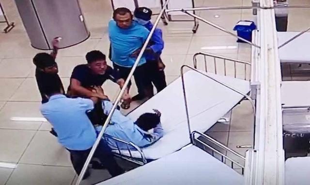 Hành hung bảo vệ bệnh viện rồi lái ôtô tông chết người - Ảnh 1.