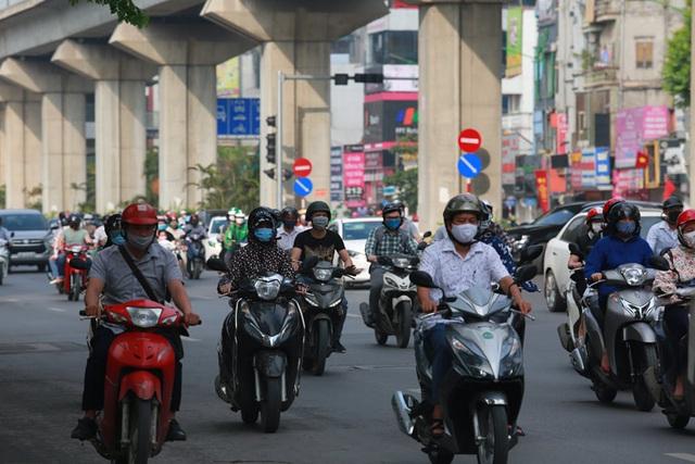 Vụ An toàn giao thông giải thích về đề xuất xe máy phải bật đèn ban ngày gây tranh cãi - Ảnh 2.