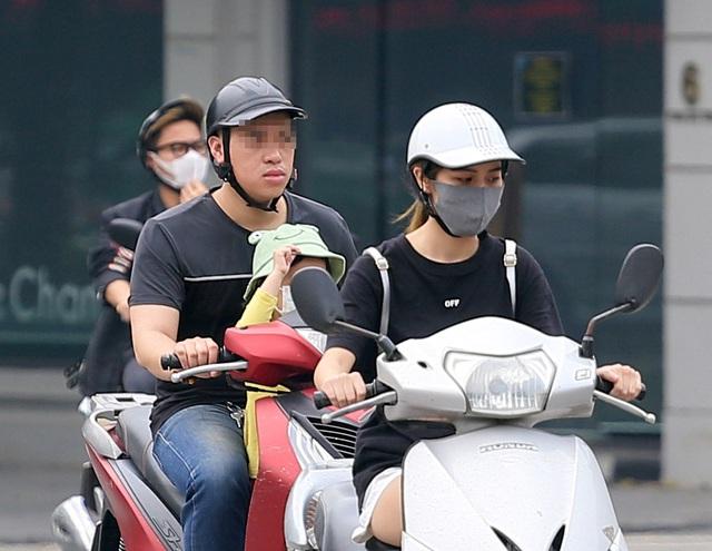 Bất chấp quy định, nhiều người vẫn không thực hiện đeo khẩu trang khi ra đường - Ảnh 3.