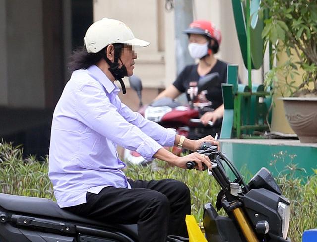 Bất chấp quy định, nhiều người vẫn không thực hiện đeo khẩu trang khi ra đường - Ảnh 4.