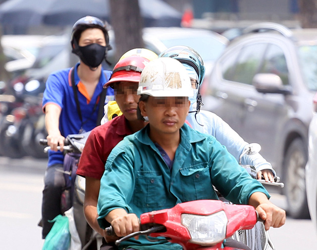 Bất chấp quy định, nhiều người vẫn không thực hiện đeo khẩu trang khi ra đường - Ảnh 14.