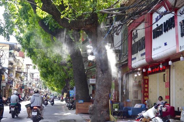 Hà Nội dự chi 114 tỷ đồng để phun nước hạ nhiệt ngày nắng gắt - Ảnh 1.