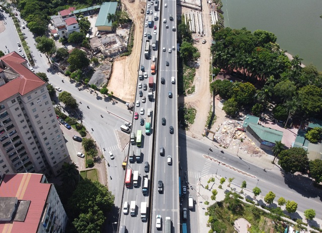Cầu vượt thấp qua hồ Linh Đàm sắp hoàn thiện khiến hàng vạn cư dân vui mừng - Ảnh 4.