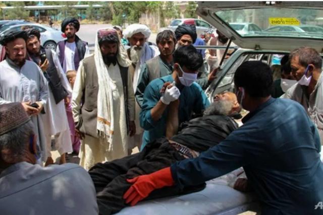 Nổ bom đẫm máu ở chợ gia súc Afghanistan, 23 dân thường thiệt mạng - Ảnh 1.