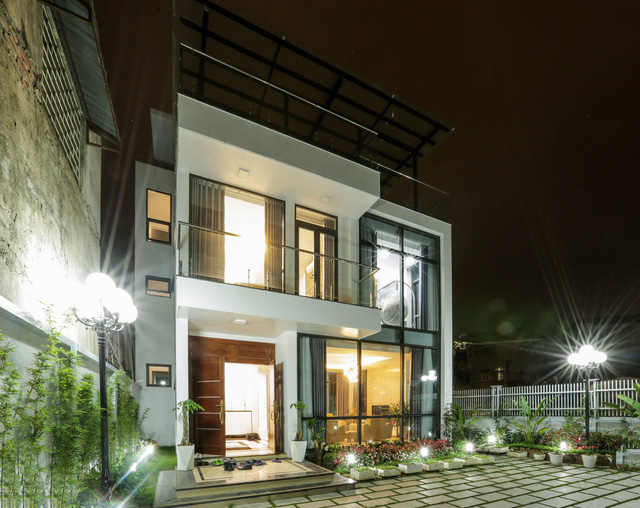 Căn biệt thự với 2 mảnh sân vườn ở Hà Nội - Ảnh 1.