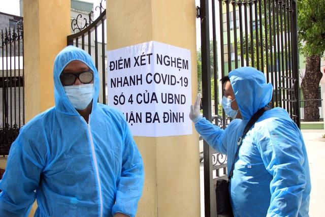 Hối hả đi xét nghiệm COVID-19, người Hà Nội thở phào khi nhận kết quả âm tính - Ảnh 8.