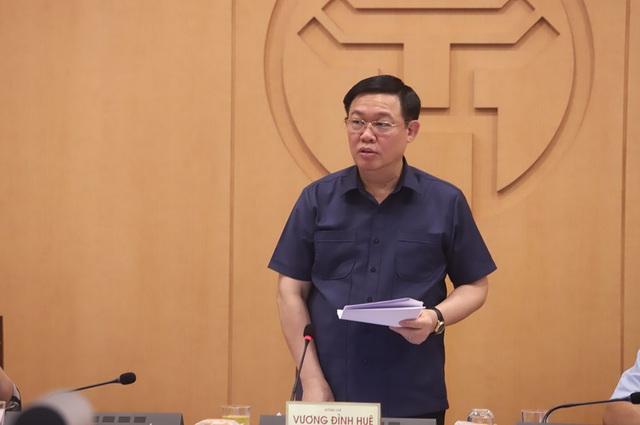 Hà Nội thực hiện giãn cách xã hội ở một số khu vực - Ảnh 3.