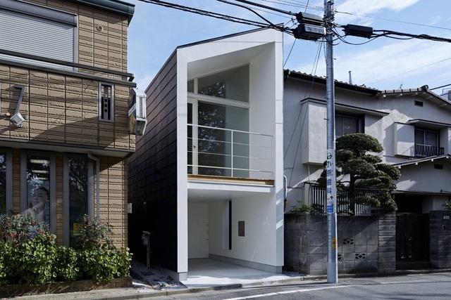 Căn nhà 27,6m² với thiết kế mái chéo độc đáo của vợ chồng trẻ ở thủ đô - Ảnh 1.