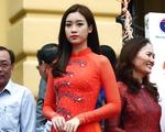 Hoa hậu Đỗ Mỹ Linh đẹp dịu dàng với tà áo dài trong Lễ kỷ niệm Ngày Dân số Thế giới 11-7