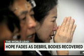 Người thân nạn nhân máy bay QZ8501 vẫn hy vọng một phép nhiệm màu