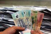 Chậm lương, người lao động được đòi thêm tiền lãi