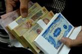 Nhân viên ngân hàng khổ vì đổi tiền lẻ