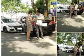 Sau va chạm xe, hai tài xế xuống bắt tay nhau và phân làn đường
