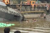Xe tải vượt đèn đỏ tông xe chở bột đá lao xuống sông, tài xế tử vong trong cabin