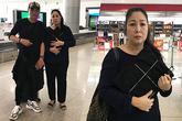 Hồng Vân ôm chặt di ảnh Anh Vũ ở sân bay