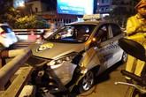 Hà Nội: Tài xế taxi ngủ gật đâm vỡ thành cầu Chương Dương