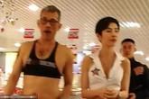 Quốc vương Thái Lan mặc crop-top đạp xe với vợ ở Thụy Sĩ