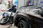 Ôtô tông 6 xe máy ở Sài Gòn, hai người bị thương