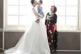 Xôn xao hình ảnh Thu Quỳnh mặc váy cưới đứng cạnh mẹ và con trai