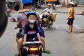 Bố chở con đi chơi bằng xe máy, nhưng vị trí ngồi của 2 đứa nhỏ khiến cả khu phố bất an