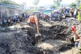 Cẩm Phả hỗ trợ gia đình đào móng di dời các phần mộ