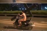 Lộ diện chàng trai ôm búp bê tình dục chạy giữa đường