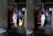Mẹ nuôi treo tay bé gái 5 tuổi lên xà nhà: Quay clip gửi cho bà nội để thấy cháu ngang bướng