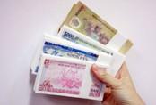 Nhân viên ngân hàng thấp thỏm trước áp lực đổi tiền lẻ mới